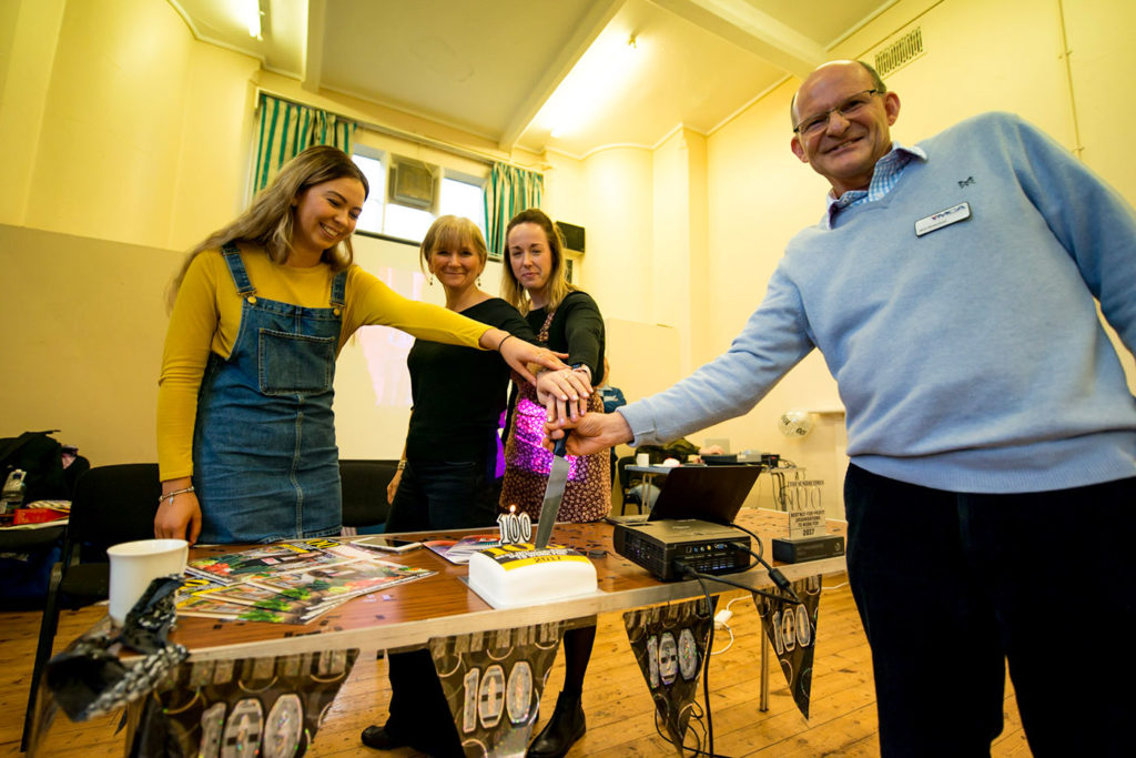 YMCA-Community-Centre-CEO-Will-Wakefield-cutting-100-year-anniversary-cake