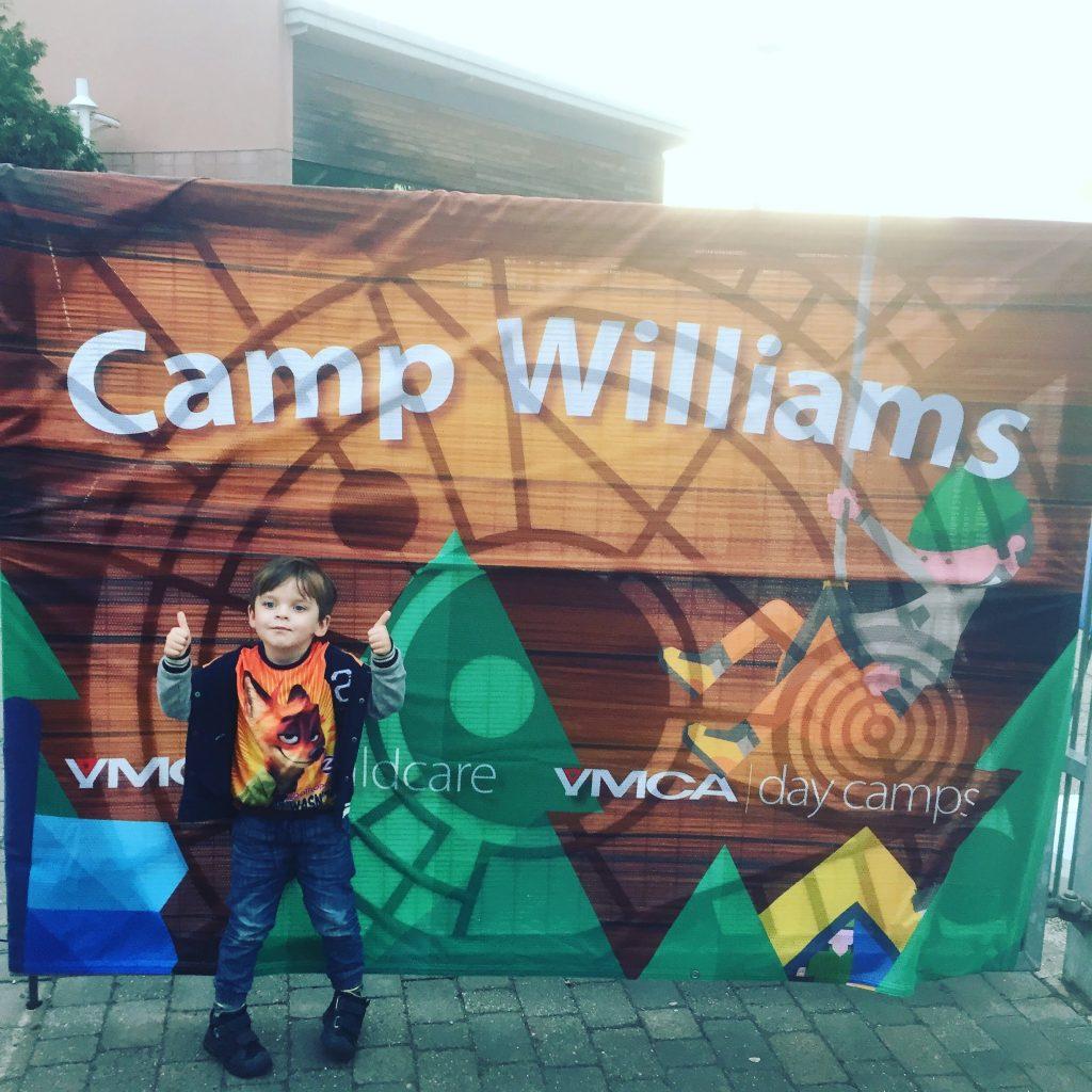 Noah-Walsh-at-Camp-Williams-sign